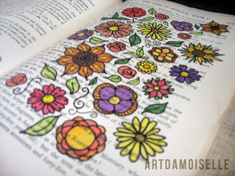 Colorful flowers doodled across a page of footnotes in a vintage textbook.