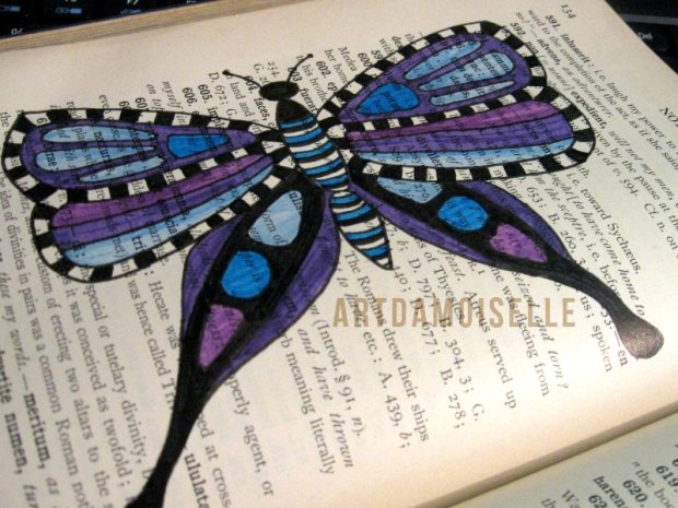 A blue and purple butterfly doodled across a page of footnotes in a vintage textbook.