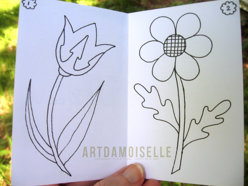 Open booklet showing simple line drawings of two flowers.